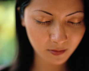 Woman closing her eyes, thinking about counseling for adults