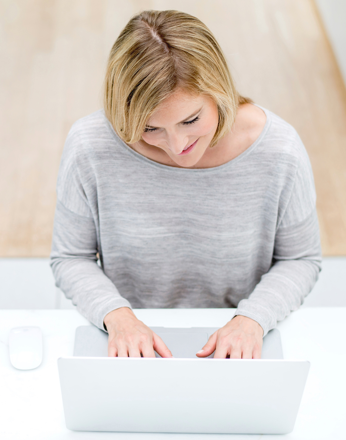 Woman looking up resources on laptop