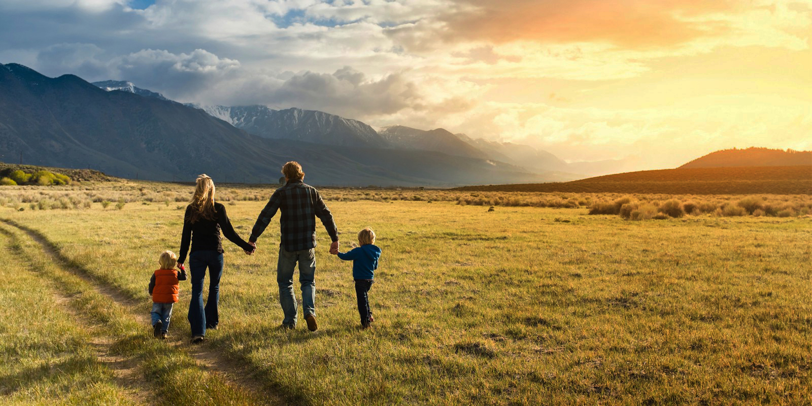 Happy family walking through field - Tricia J. Mlnarik, LMFT, family counseling in San Jose, CA